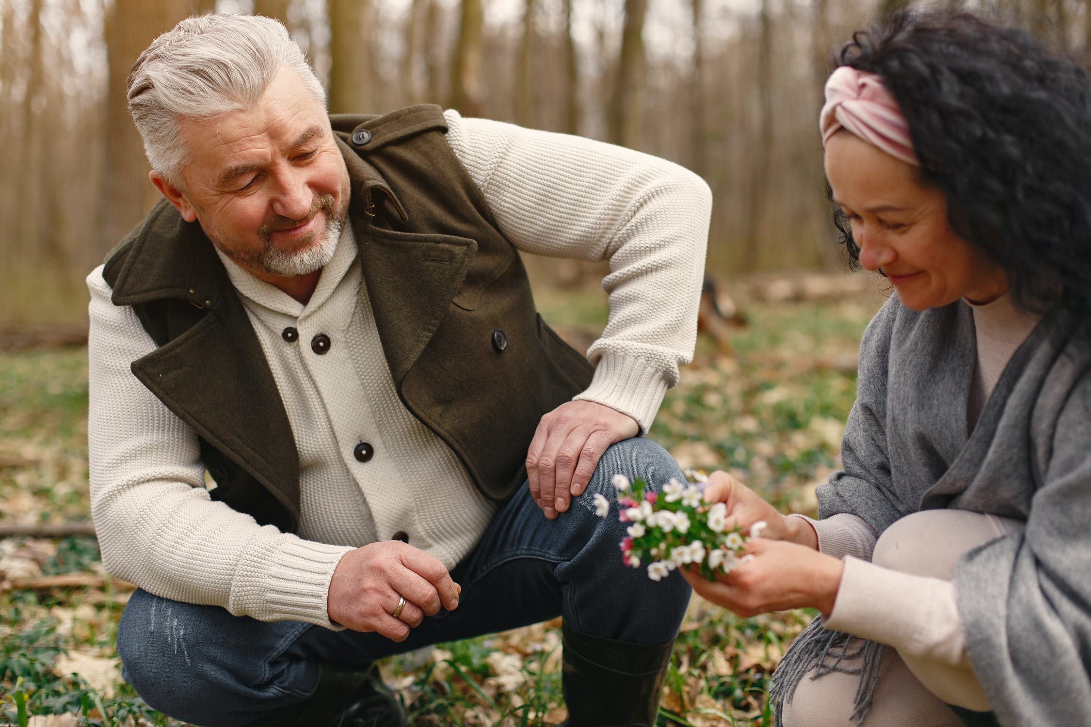 Happy older couple picking flowers